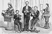 0070855 © Granger - Historical Picture ArchiveJOHN MASKELYNE (1839-1917).   John Nevil Maskelyne. English magician. Maskelyne with four of his mechanical people. Line engraving, 19th century.