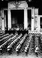 0017040 © Granger - Historical Picture ArchiveHITLER & MUSSOLINI, 1930s.   German Chancellor Adolf Hitler and Italian dicatator Benito Mussolini reviewing Italian troops during Hitler's visit to Rome, Italy, in the 1930s.