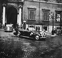 0174431 © Granger - Historical Picture ArchiveHITLER & MUSSOLINI, c1938.   German chancellor Adolf Hitler and Italian dictator Benito Mussolini, leaving the Quirinal Palace in Rome, during Hitler's visit to Italy, c1938. Photograph by Heinrich Hoffmann.