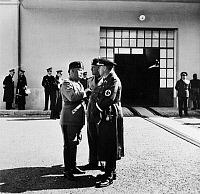 0174435 © Granger - Historical Picture ArchiveBENITO MUSSOLINI   (1888-1945). Italian dictator. Mussolini (left) with German Foreign Minister Joachim von Ribbentrop (right) and his Italian counterpart, Count Galeazzo Ciano, at Furbara Airport in Rome. Photograph by Heinrich Hoffmann, c1938.