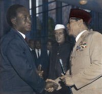 0061875 © Granger - Historical Picture ArchiveNKRUMAH AND SUKARNO, 1960.   President Kwame Nkrumah of Ghana (left) shaking hands with President Sukarno of Indonesia at the United Nations in New York, 4 October 1960, while Prime Minister Jawaharlal Nehru of India watches. Oil over a photograph.