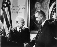 0174539 © Granger - Historical Picture ArchiveJ. ROBERT OPPENHEIMER   (1904-1967). American physicist. Oppenheimer shaking hands with President Lyndon Johnson at a ceremony presenting Oppenheimer with the Enrico Fermi Award on 2 December 1963. Photograph signed by President Johnson.