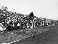 0170348 © Granger - Historical Picture ArchiveJAMES 'JESSE' OWENS   (1913-1980). American athlete. Owens in the midst of his broad jump leap, which was responsible for one of the four gold medals he won and three track-and-field records he set at the 1936 Berlin Olympic Games.