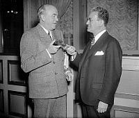0119213 © Granger - Historical Picture ArchiveFERDINAND PECORA   (1882-1971). American jurist. Pecora, right, photographed with former Minnesota Supreme Court Justice John P. Devaney, whom Pecora succeeded as the President of the National Lawyers Guild. Devaney relinquishing the gavel during the annual convention in Washington, D.C., 22 February 1938.