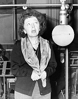 0127064 © Granger - Historical Picture ArchiveÉDITH PIAF (1915--1963).   Née Édith Giovanna Gassion. French singer and actress.  Singing at a recording studio in Paris, 1 February 1962.