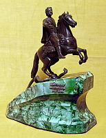 0127333 © Granger - Historical Picture ArchivePETER I (1672-1725).   Czar of Russia, 1682-1725. Equestrian sculpture on a malachite base, modeled after the statue in Saint Petersburg by Etienne-Maurice Falconet, 1782.