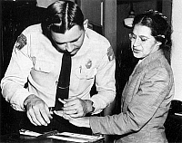 0029329 © Granger - Historical Picture ArchiveROSA PARKS (1913-2005).   American civil rights advocate. Rosa Parks fingerprinted by Lieutenant Drue H. Lackey in Montgomery, Alabama, 22 February 1956, following her arrest for her role in organizing a boycott of the city's buses to protest their racial segregation of passengers.