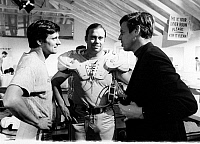 0099845 © Granger - Historical Picture ArchiveGEORGE PLIMPTON (1927-2003).   American writer and editor. Plimpton (far right) with John Gordy (center), Detroit Lions guard, and Alan Alda during the filming of 'Paper Lion,' based on Plimpton's book. Photographed 12 March 1968.