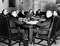 0621396 © Granger - Historical Picture ArchiveFRANKLIN DELANO ROOSEVELT  (1882-1945). 32nd President of the United States. Meeting with his cabinet in an emergency session. Seated clockwise: President Roosevelt, Henry Morgenthau, Homer Cummings, Claude Swanson, Henry Wallace, Frances Perkins, Harry Woodring, and Cordell Hull. Photograph, 1938.