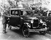 0622610 © Granger - Historical Picture ArchiveJOHN D. ROCKEFELLER  (1839-1937). American oil magnate. With a Ford automobile. Photograph, c1925.