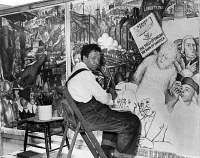 0623370 © Granger - Historical Picture ArchiveDIEGO RIVERA (1886-1957).   Mexican artist. Painting a mural depicting class conflict in the United States. Photograph, 1933.