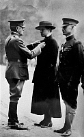 0186640 © Granger - Historical Picture ArchiveJULIA CATHERINE STIMSON   (1881-1948). Chief of the Army Nurse Corps, being decorated with the Distinguished Service Medal by General John J. Pershing in Tours, France. Photographed during World War I, c1918.