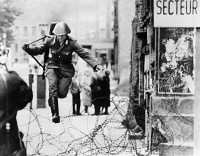 0622695 © Granger - Historical Picture ArchiveCONRAD SCHUMANN (1942-1998). German soldier known for defecting from East Germany to West Germany during the construction of the Berlin Wall. Leaping over the barbed wire separating East Berlin from West Berlin. Photograph, 15 August 1961.