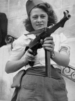 0622772 © Granger - Historical Picture ArchiveSIMONE SEGOUIN (1925- ).   Also known as Nicole Minet. French resistance fighter during World War II. Posing with a submachine gun during the liberation of Chartres. Photograph by Jack Belden, 23 August 1944. Full Credit: Rue des Archives/Tallandier / Granger, NYC. All Rights Reserved.