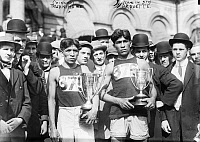 0621730 © Granger - Historical Picture ArchiveLEWIS TEWANIMA (1888-1969).   American Hopi Indian Olympic runner. After being awarded with a first-place trophy after a marathon in New York City; fifth-place finisher Mitchell Arquette stands to the right. Photograph, 6 May 1911.