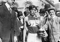 0621731 © Granger - Historical Picture ArchiveLEWIS TEWANIMA (1888-1969).   American Hopi Indian Olympic runner. After being awarded with a first-place trophy after a marathon in New York City. Photograph, 6 May 1911.