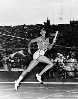 0170222 © Granger - Historical Picture ArchiveWILMA RUDOLPH (1940-1994).   American track and field athlete. Crossing the finish line to win the 400-meter relay for the United States at the Summer Olympic Games in Rome, Italy, 8 September 1960.