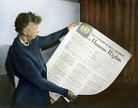 0054612 © Granger - Historical Picture ArchiveANNA ELEANOR ROOSEVELT   (1884-1962). Mrs. Franklin Delano Roosevelt. Eleanor Roosevelt holding a Universal Declaration of Human Rights poster at Lake Success, New York. Oil over a photograph, November 1949.