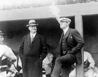 0121378 © Granger - Historical Picture ArchiveJOHNSON & RUTH, 1922.   American baseball executive Ban Johnson (left) smoking cigars at a baseball game in Washington, D.C, with New York Yankees star Babe Ruth, 12 April 1922.