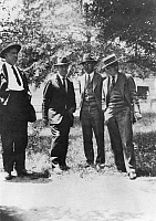 0017073 © Granger - Historical Picture ArchiveJOHN T. SCOPES (1900-1970).   American educator. Waiting on the courthouse lawn in Dayton, Tennessee in July 1925 are (left to right): John T. Godsey, lawyer for Scopes; Dr. John R. Neal, Scopes' leading counsel; John T. Scopes; and George Rappleyea.