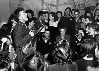 0104942 © Granger - Historical Picture ArchivePETE SEEGER (1919-2014).  American folk singer and composer. Performing at the opening of the Washington D.C. labor canteen, sponsored by the United Federal Labor Canteen and the Congress of Industrial Organizations (CIO). Eleanor Roosevelt is in the audience. Photograph by Joseph Horne, 1944.