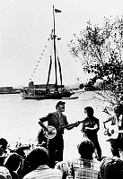 0108971 © Granger - Historical Picture ArchivePETE SEEGER (1919-2014).  American folk singer and composer. Seeger performing along the banks of the Hudson River at Rensselaer, New York, for the launch of the 'Clearwater,' an old-fashioned ship commissioned by Seeger and a group of anti-pollution advocates. Photographed 1969.
