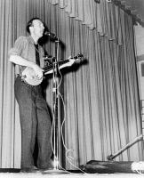 0395087 © Granger - Historical Picture ArchivePETE SEEGER (1919-2014).   American folk singer and composer. Performing at Yorktown Heights High School in Yorktown, New York. Photograph by James Kavallines, 2 February 1967.
