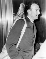 0395088 © Granger - Historical Picture ArchivePETE SEEGER (1919-2014).   American folk singer and composer. Arriving at court. Photograph by Walter Albertin, 4 April 1961.