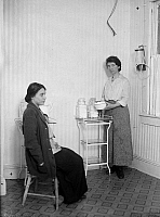 0266798 © Granger - Historical Picture ArchiveMARGARET SANGER   (1879-1966). American birth control activist, sex educator, and nurse. Photographed with a patient, c1920.