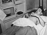 0034777 © Granger - Historical Picture ArchiveDUTCH SCHULTZ (1902-1935).   Originally, Arthur Flegenheimer, American gangster. A visibly wounded and scared 'Dutch' Schultz on a Newark City Hospital operating table, 1935.