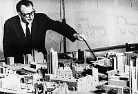0108776 © Granger - Historical Picture ArchiveEERO SAARINEN (1910-1961).   Finnish architect. Saarinen with a models of new buildings he has designed for Yale University, New Haven, Connecticut. Photographed 1959.