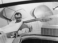0114521 © Granger - Historical Picture ArchiveEERO SAARINEN (1910-1961).   Finnish architect. With a scale model of the TWA Terminal at Kennedy Airport, New York. The terminal was completed in 1962, after Saarinen's death.