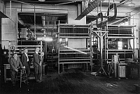 0175798 © Granger - Historical Picture ArchiveCHARLES PROTEUS STEINMETZ   (1865-1923). American (German-born) electrical engineer. Steinmetz (left) photographed in his laboratory at General Electric in Schenectady, New York, during a demonstration of his artificial lightning generator, 1922.