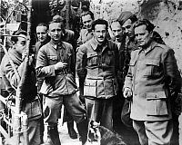 0004147 © Granger - Historical Picture ArchiveTITO W/ YUGOSLAV PARTISANS.   Josep Tito, far right, and fellow partisans in a Yugoslavian mountain retreat during World War II.