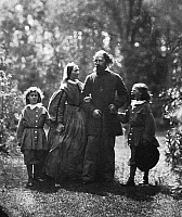 0013999 © Granger - Historical Picture ArchiveALFRED TENNYSON (1809-1892).   1st Baron Tennyson. English poet. Lionel, Emily, Alfred and Hallam Tennyson at Farringford, England, c1862-64. Photographed by Oscar Gustav Rejandler or Lewis Carroll.