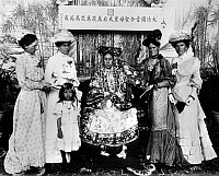 0006754 © Granger - Historical Picture ArchiveTZ'U HSI (1835-1908).   Empress dowager of China, 1875-1908. The empress (center) photographed sometime after her 1902 return to Peking, with the wives of foreign diplomats and their adopted Chinese orphan.