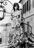 0622142 © Granger - Historical Picture ArchiveRAQUEL WELCH (1940-).   American singer and actress. Posing next to a lantern in Rome, Italy. Photograph, 1967.