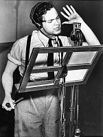 0326118 © Granger - Historical Picture ArchiveORSON WELLES (1915-1985).   American director, producer, screenwriter, and actor. Welles during the broadcast of the radio adaptation of H.G. Wells' 'The War of the Worlds,' at CBS studios in New York City. Photograph, October 1938. Full credit: FIA - Rue des Archives / Granger, NYC -- All rights re