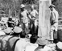 0001881 © Granger - Historical Picture ArchiveORDE CHARLES WINGATE   (1903-1944). British soldier. Major General Wingate, wearing pith helmet, briefing American and British officers on plans to invade Burma behind Japanese lines during World War II. At right is Colonel Philip J. Cochran, USAF, Commander of the First Air Commando Force.