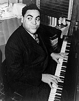 0268425 © Granger - Historical Picture ArchiveTHOMAS 'FATS' WALLER   (1904-1943). American musician and composer. Photograph by Alan Fisher, 1938.