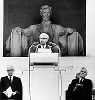 0113264 © Granger - Historical Picture ArchiveEARL WARREN (1891-1974).   American jurist. Warren (left) listens as former Supreme Court Justice Arthur Goldberg delivers a speech at a public tribute to him, in front of the Lincoln Memorial in Washington, D.C., 29 June 1969. Chief Justice Warren E. Burger sits at right.