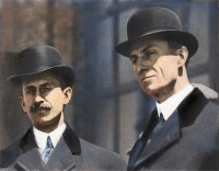 0043295 © Granger - Historical Picture ArchiveWRIGHT BROTHERS.   Orville (left) (1871-1948) and Wilbur Wright (1867-1912). American pioneers in aviation. Oil over a photograph.