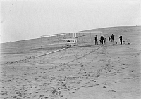 0264472 © Granger - Historical Picture ArchiveWRIGHT BROTHERS AIRPLANE.   The Wright brothers' flying machine at the launching track at Big Kill Devil Hill in Kitty Hawk, North Carolina. Photograph, 14 December 1903.