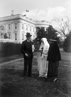 0323410 © Granger - Historical Picture ArchiveCALVIN COOLIDGE (1872-1933).   30th President of the United States. Buying tuberculosis seals from a representative of the American Lung Association. Photograph, December 1924.