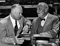 0170031 © Granger - Historical Picture ArchiveDWIGHT D. EISENHOWER   (1890-1969). 34th President of the United States. Photographed during the 1952 presidential campaign, conferring with his foreign policy advisor (and future Secretary of State) John Foster Dulles (right) on a park bench in Morningside Heights, New York City, 11 June 1952.