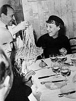 0259728 © Granger - Historical Picture ArchiveEISENHOWER FAMILY, 1952.   Mamie Eisenhower laughing over spaghetti during a dinner in Rome, Italy, May 1952.
