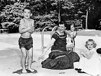 0259737 © Granger - Historical Picture ArchiveEISENHOWER FAMILY.   Mamie Eisenhower and and her grandchildren David, Barbara Anne and Susan, at a swimming pool. Photograph, c1955.