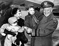 0259759 © Granger - Historical Picture ArchiveDWIGHT D. EISENHOWER   (1890-1969). 34th President of the United States. Eisenhower greeted by his wife, Mamie, and their grandchildren, David and Barbara Anne, at Stewart Field at West Point, New York. Photograph, 27 January 1951.