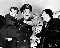 0259765 © Granger - Historical Picture ArchiveDWIGHT D. EISENHOWER   (1890-1969). 34th President of the United States. Eisenhower greeted by his wife, Mamie, and their David and Barbara Anne at Stewart Field at West Point, New York. Photograph, 27 January 1951.