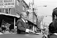 0125906 © Granger - Historical Picture ArchiveGERALD FORD (1913-2006).   38th President of the United States. Waving to crowds from the sunroof of a car during a campaign stop in Philadelphia, Pennsylvania, September 1976. Photographed by Marion S. Trikosko.